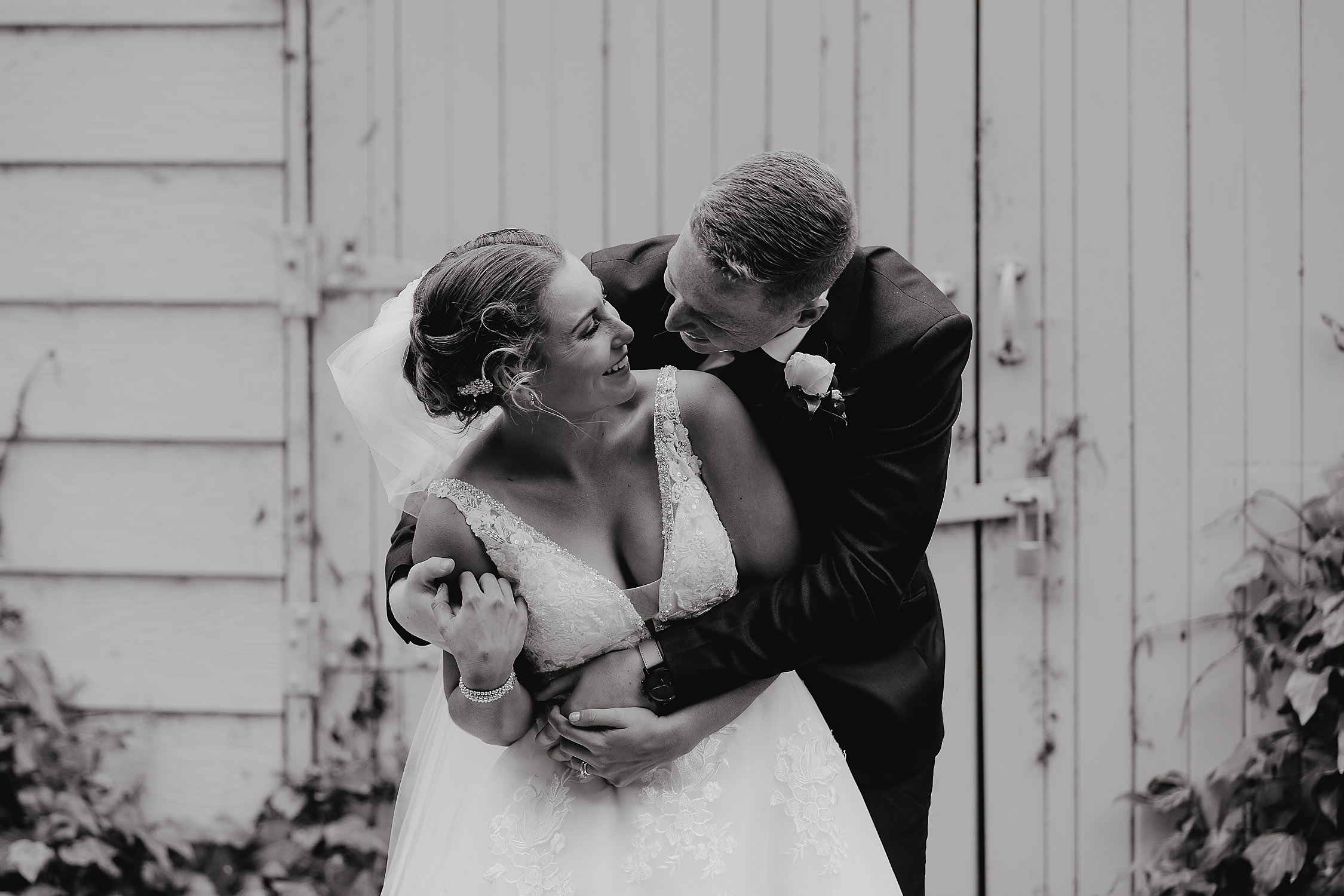 bride and groom laughing together wedding photographer christchurch