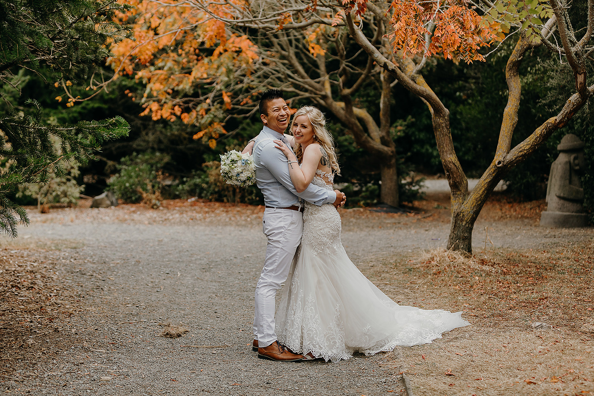 bride and groom laughing halswell quarry autumn leaves christchurch wedding photographer