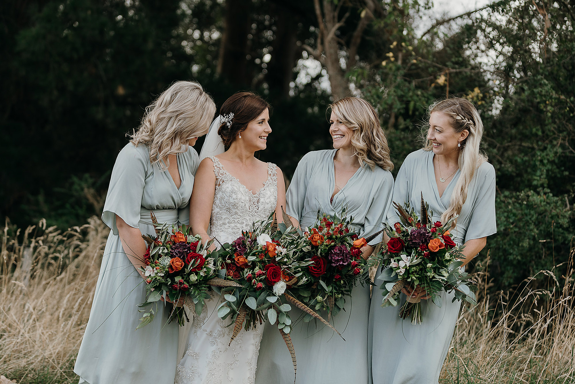 Christchurch Wedding Photographer wedding photo of bride and bridesmaids laughing together at Mt Vernon Lodge Akaroa Rebecca Claridge Photography