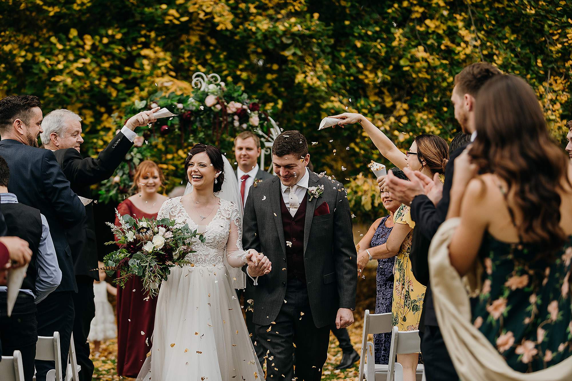 Christchurch Wedding Photographer bride and groom just married confetti throw at Riccarton House Christchurch Rebecca Claridge Photography