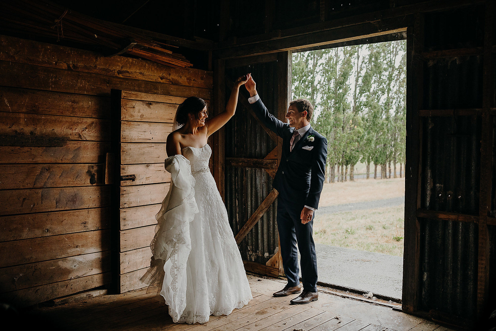 bridie and groom dancing in woolshed at rossendales vineyard Christchurch Wedding Photographer