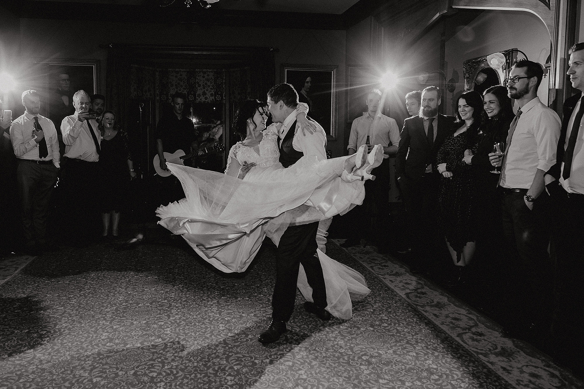 Christchurch Wedding Photographer first dance lift with bride and groom at Riccarton House Christchurch Rebecca Claridge Photography