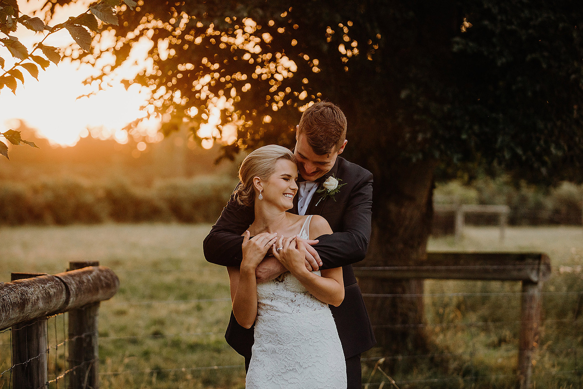bride and groom cuddling at sunset golden hour christchurch wedding photographer