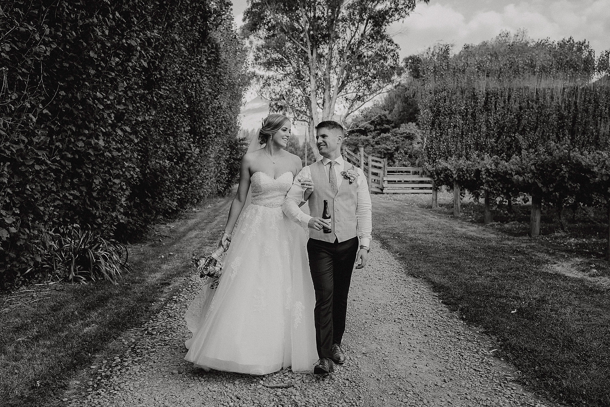 Christchurch Wedding Photographer wedding photo of bride and groom walking together at Cossars Wineshed Christchurch Rebecca Claridge Photography