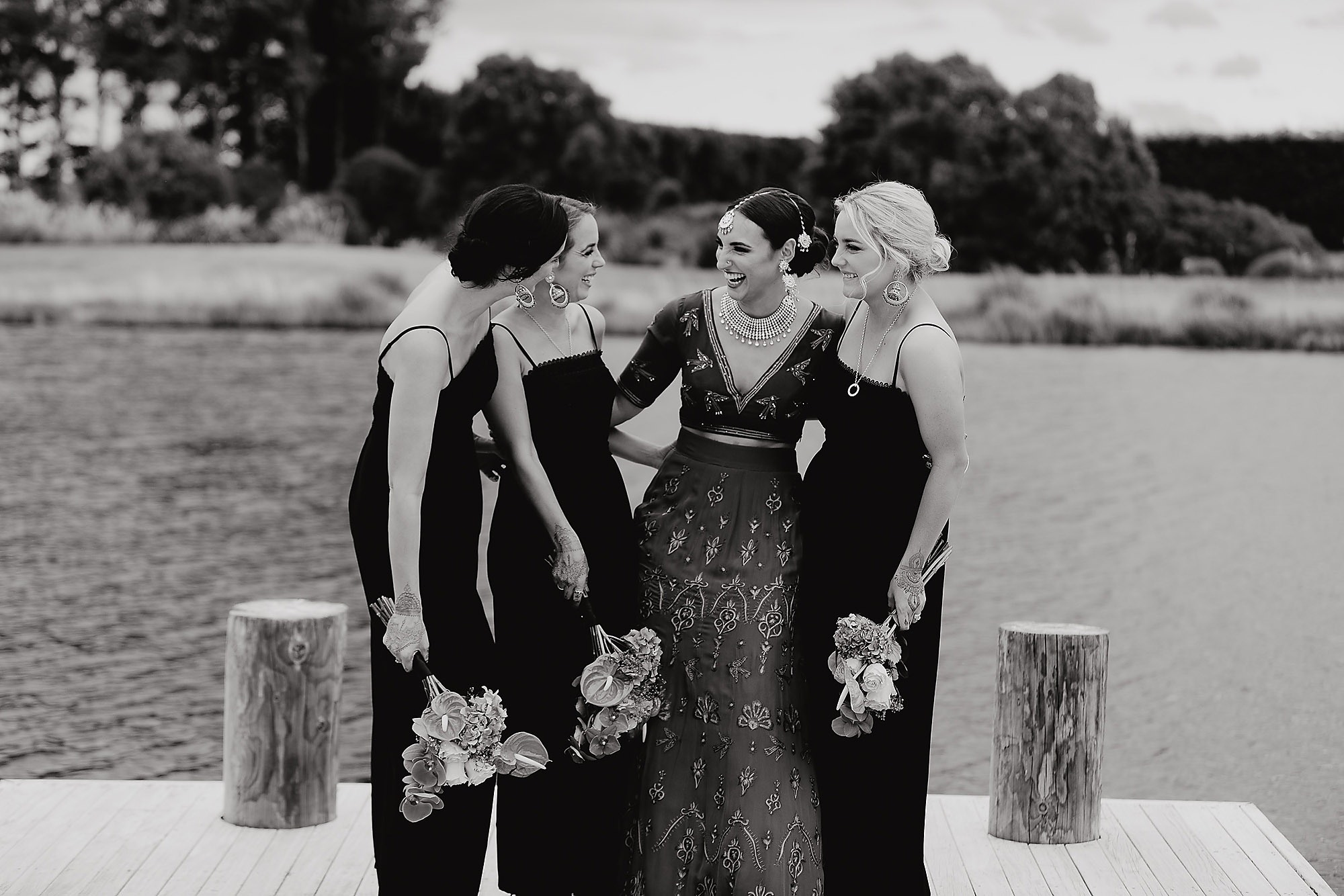 bride and her bridesmaids laughing together Christchurch Wedding Photographer