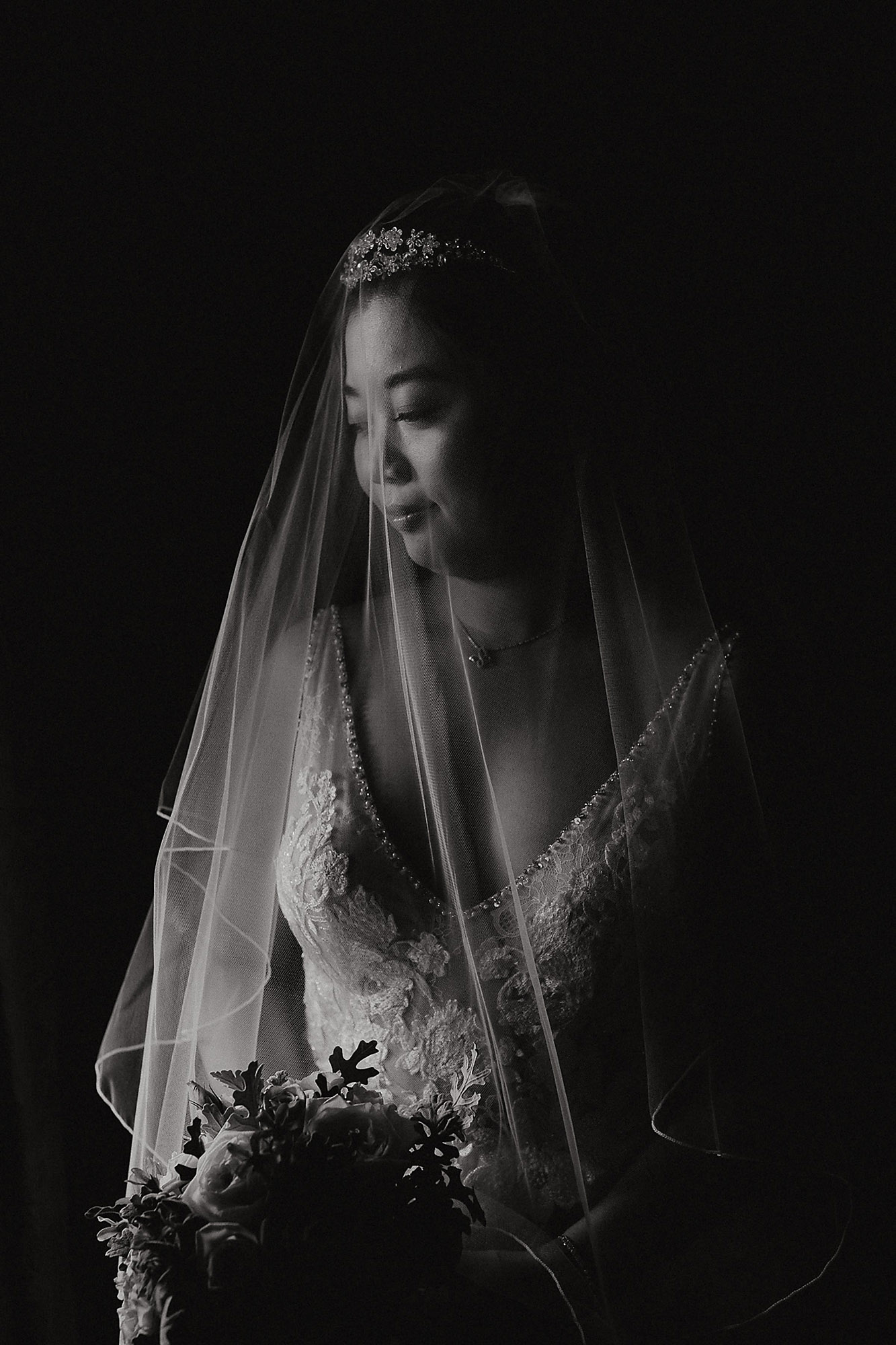 Christchurch Wedding Photographer bride portrait with veil with window light at Riccarton House Christchurch Rebecca Claridge Photography