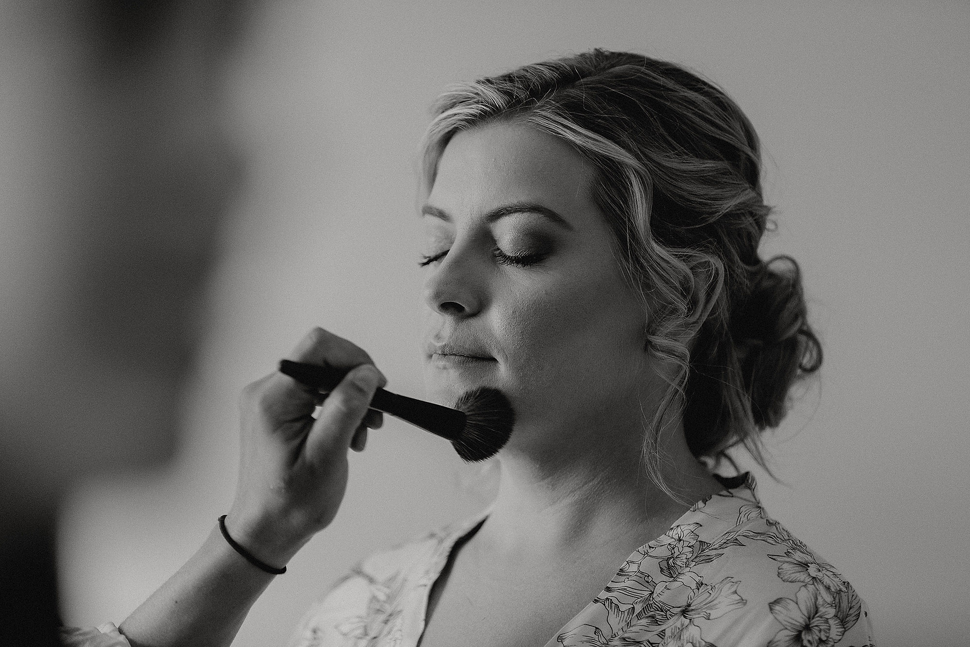 bride getting her make up done before wedding christchurch wedding photographer