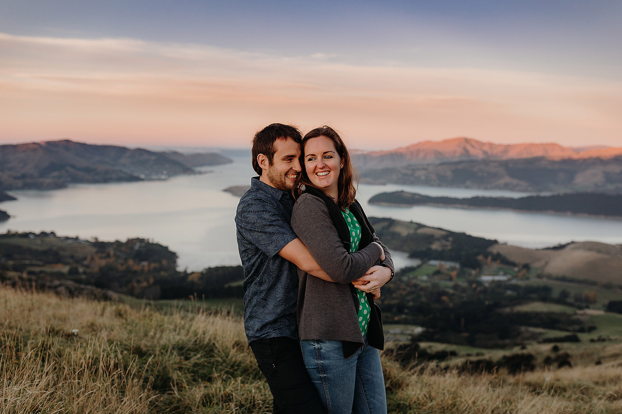 Engagement & Couples photographer in Christchurch sunset photo of couple at port hills with dusk colours