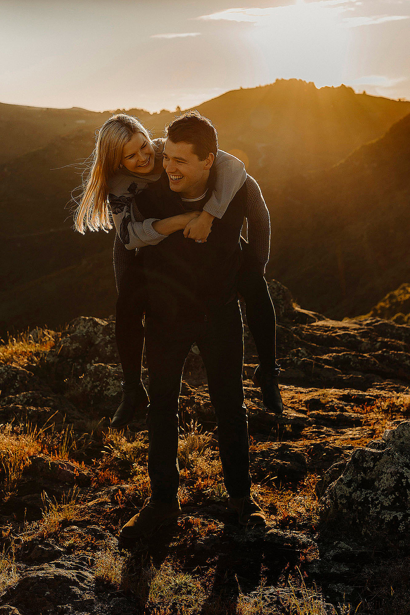 couple laughing giving piggy back during photo session in port hills christchurch couples photographer