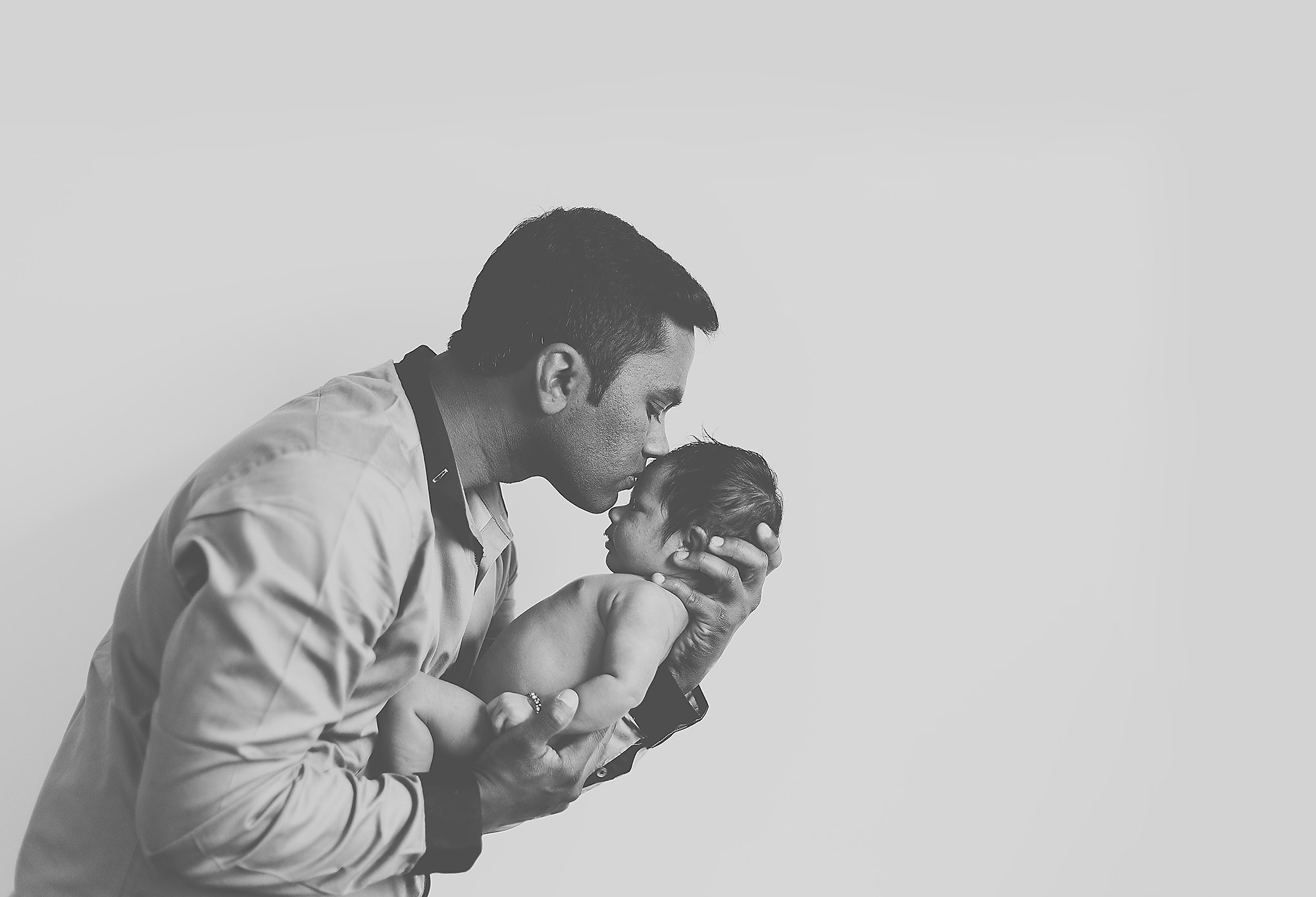 Christchurch Portrait Photographer newborn portrait baby and dad kissing head black and white