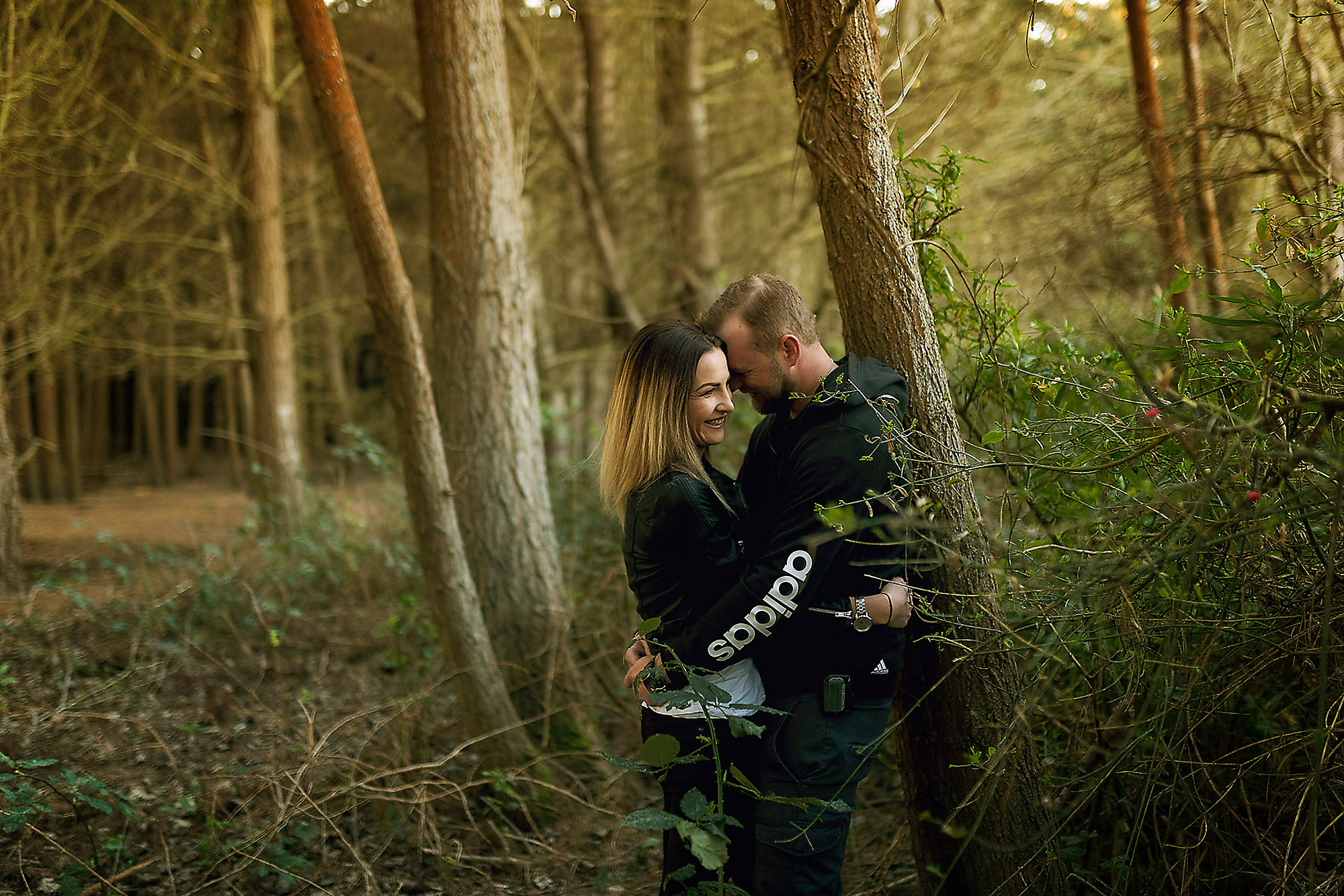 Engagement & Couples photographer in Christchurch couple laughing in the forest bottle lake forest