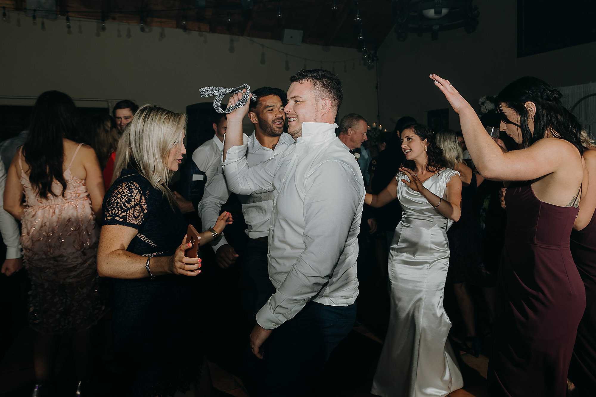 Christchurch Wedding Photographer wedding dance floor fun reception photo Cossars Wineshed Christchurch Rebecca Claridge Photography