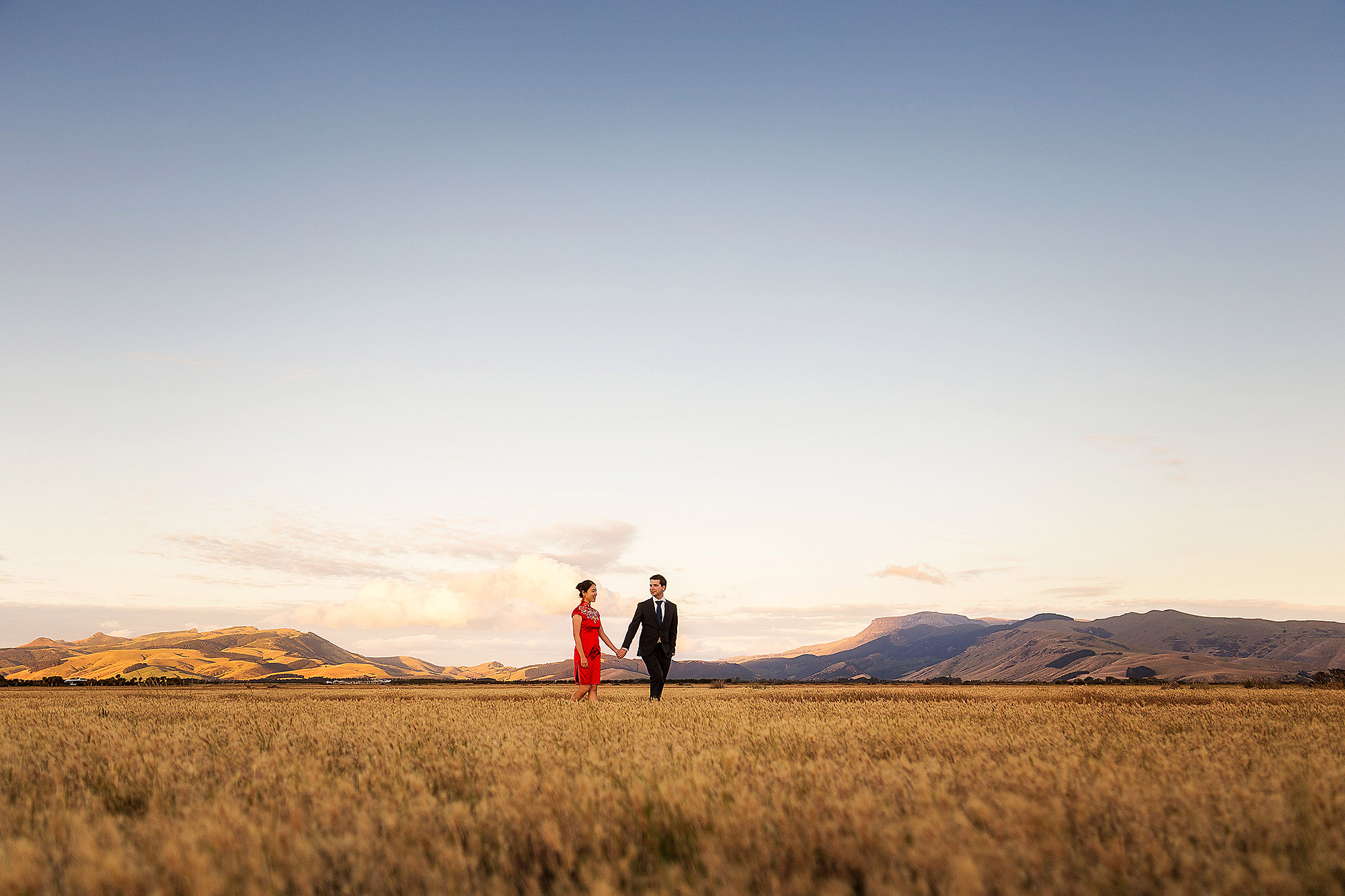 Engagement & Couples photographer in Christchurch couple walking at sunset at lake ellesmere