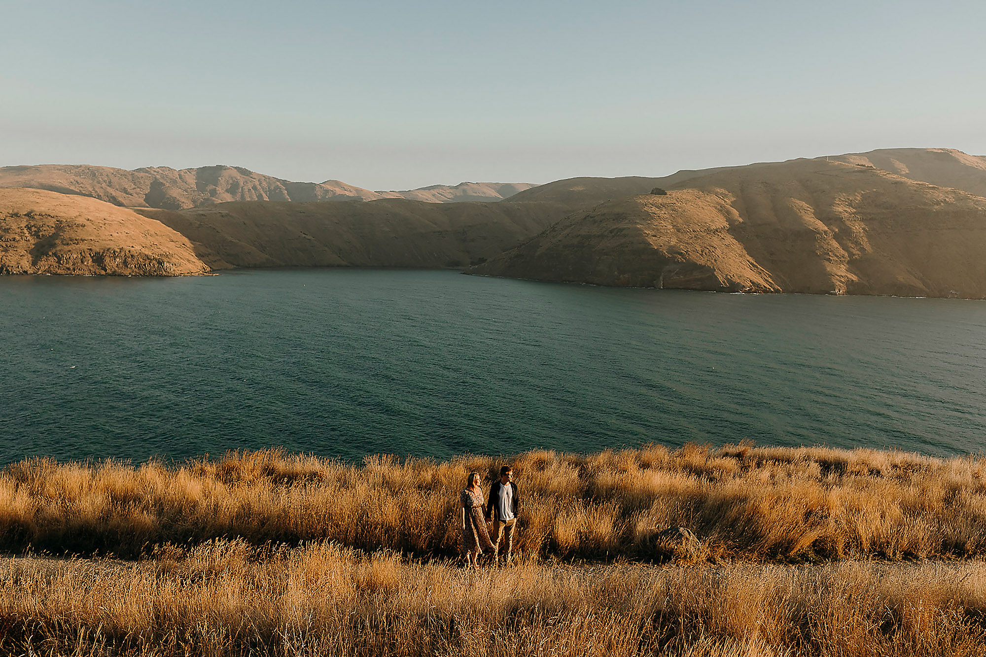Engagement & Couples photographer in Christchurch couples portrait at godley head at sunset