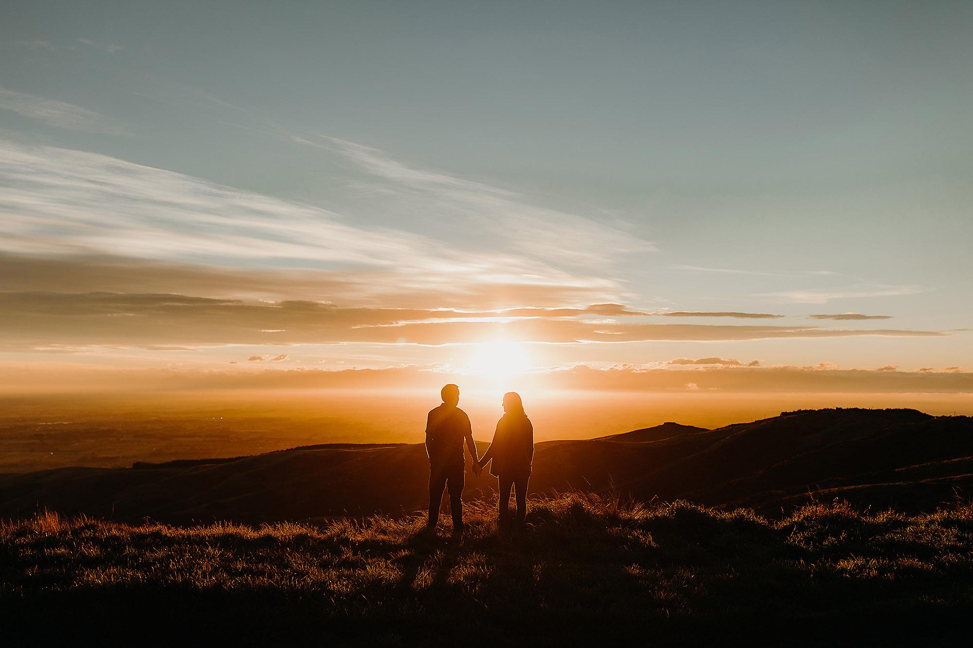 Engagement & Couples photographer in Christchurch sunset silhouette couple at port hills