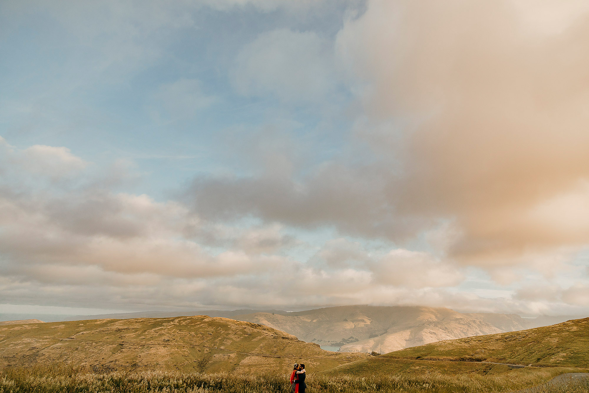 landscape photo with couple in the port hills at sunset christchurch wedding photographer