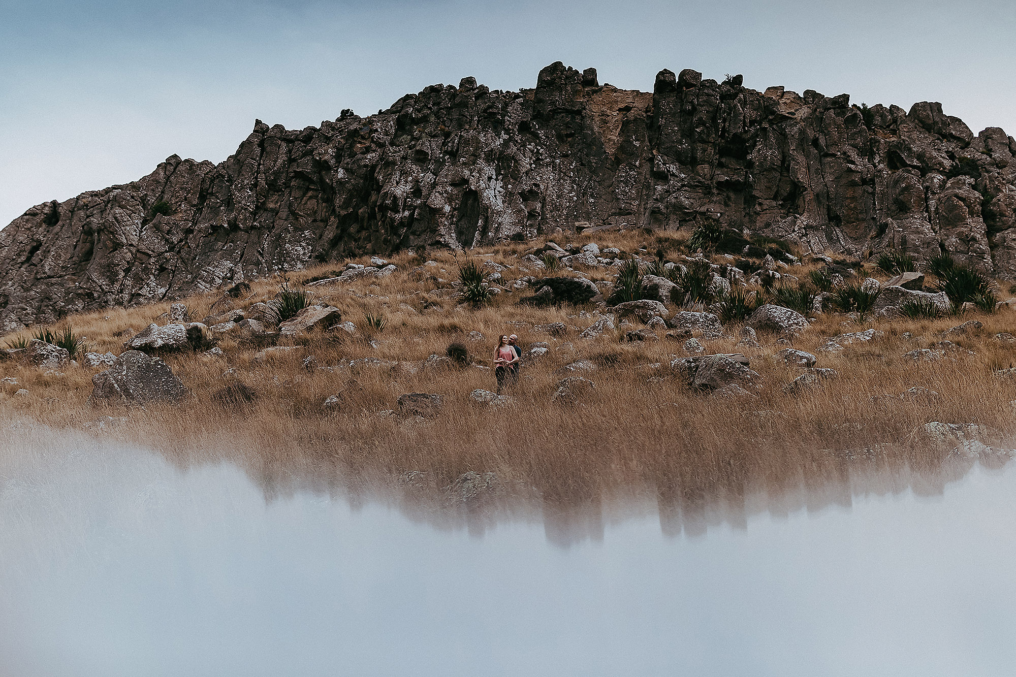 Engagement & Couples photographer in Christchurch landscape of hill with couple and reflection